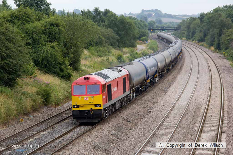 130720-024     DB Schenker class 60 no 60010 is seen passing Hasland, Chesterfield, powering the diverted 6E54, 10.40 Kingsbury Oil Sidings to Humber Oil Refinery, empty fuel-oil tanks.