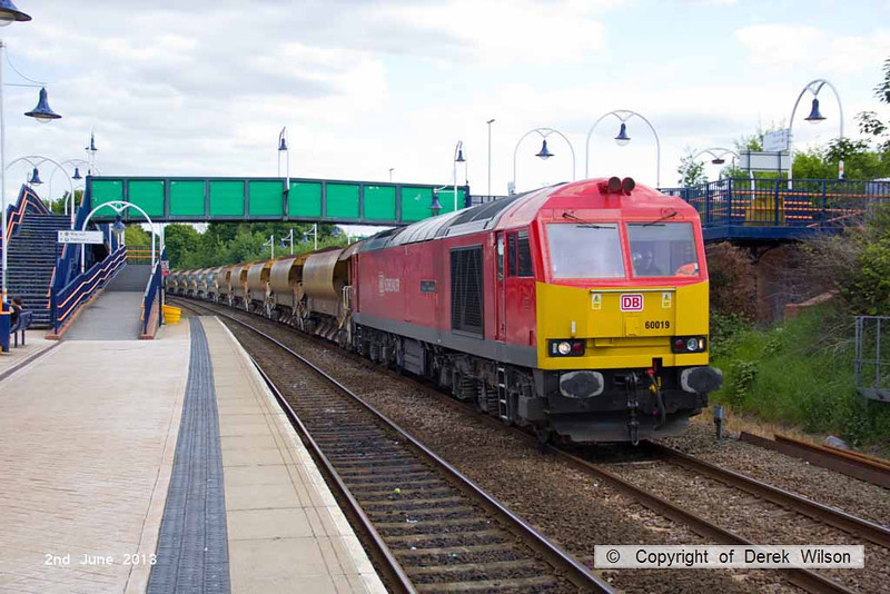 130602-015     DB Schenker 'super tug', class 60 no. 60019 Port of Grimsby & Immingham working 'top & tail' with 66059 is seen passing through Mansfield Woodhouse, powering engineers train 6B18, 1633 Toton North Yard to Kirkby Lane End Jn. The ensemble was heading to Shirebrook to cross on to the up main, then led by 66059 returned, heading onto the possession at Kirkby where the Robin Hood Line through to Nottingham was closed for track renewal work.