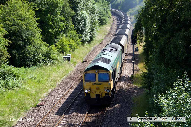 130706-016     Freightliner class 66/5 no 66554, captured passing Barrow Hill powering train 6G10, 0900 Kellingley Colliery to Ratcliffe power station, loaded coal hoppers.