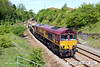 130602-006     DB Schenker class 66/0 no. 66025 is seen leaving the possession at Kirkby Lane End Junction, at the rear of 6B16, 1454, Kirkby Lane End Jn to Toton North Yard engineers train. Led by classmate 66136 it was heading to Shirebrook to cross-over & return, then taking the freight line through Pinxton which can be seen to the left of the picture.