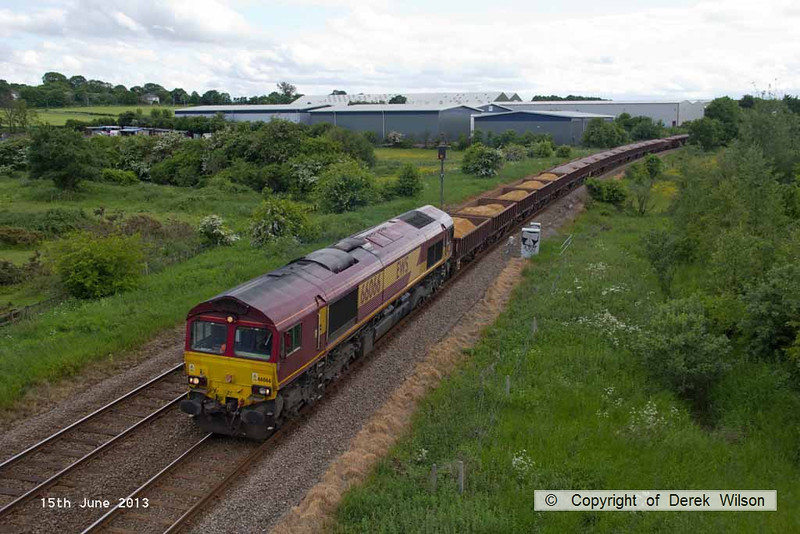 130615-005      DB Schenker class 66/0 no. 66066 is captured passing Sutton in Ashfield working top & tail, along with 66014 which is out of sight. The ensemble was working engineers train 6T61, 1700 Toton North Yard to Shireoaks West Jn., conveying sand, ballast & concrete sleepers for track renewal work in the Dinnington area.