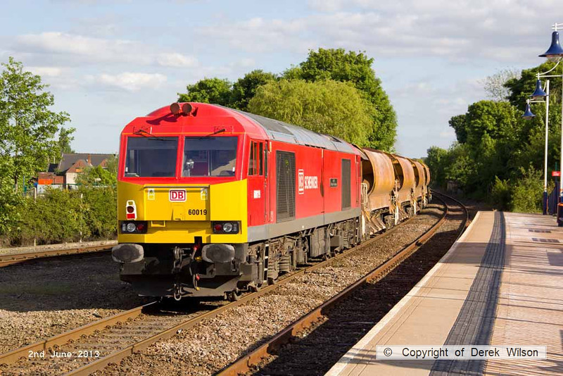 130602-025     DB Schenker 'super tug', class 60 no. 60019 Port of Grimsby & Immingham working 'top & tail' with 66059 is captured in glorious sunlight, passing through Mansfield Woodhouse powering engineers train 6B18, 1633 Toton North Yard to Kirkby Lane End Jn.