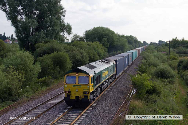 130726-004     Freightliner class 66/5 no 66503 The Railway Magazine, seen from the footbridge to the south of Willington, powering Intermodal service, train 4O54, 06.13 Leeds FLT to Southampton MCT.