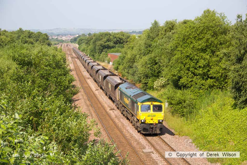 130706-008     Freightliner class 66/5 no 66598, captured passing Barrow Hill powering the 0630 Ratcliffe power station to Hull Kingston Terminal, empty coal hoppers.