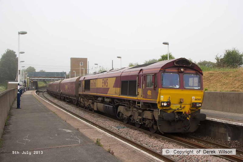 130709-002     DB Schenker class 66/0 no 66068 is seen passing through Retford Low Level station, powering train 6F04, 0438 Immingham, Humber International Terminal to Cottam Power Station, loaded coal hoppers.