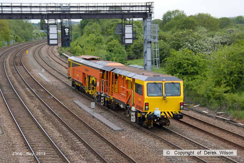 130523-022     Colas Rail's Plasser and Theurer  tamper no. DR 73908 is seen passing Stapleford, near Toton, running as the 10.00 Trent Sidings to Butterley M.R.C., headcode unknown.