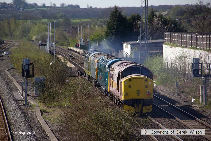 130502-014     Deltic, class 55 no. 55009 Alycidon is captured passing Langley Mill, hauling 33108, classmate 55019 & 37251, which is nearest at the rear of the ensemble. The convoy was heading to the Dean Forest Railway as 0Z74 1000 Butterley M.R.C. to Lydney Junction where 31466 was attached. The following day the convoy completed it's journey to the Swanage Railway for the forthcoming diesel gala.