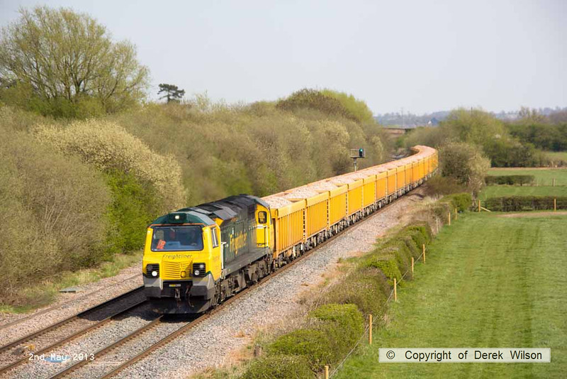 130502-055     Freightliner class 70 no. 70015, captured passing Barrow upon Trent powering train 6U77, 1344 Mountsorrel to Crewe Basford Hall, loaded (ballast) bogie boxes.
