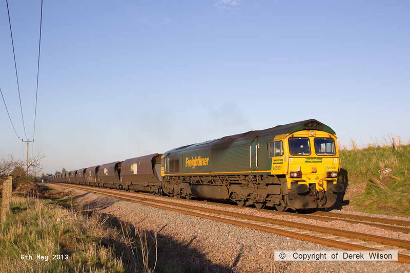 130506-004     Freightliner class 66/5 no. 66510 is captured in some nice evening light, passing Edwinstowe with a rake of loaded coal hoppers, running as the 19.00 Thoresby Colliery to Ratcliffe power station.