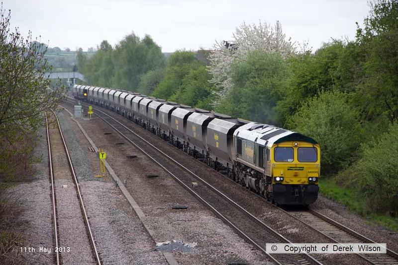 130511-009     Freightliner class 66/5 no. 66595 passes Langley Mill, powering train 4E15, 0824 Ratcliffe Power Station to Doncaster Down Decoy, hauling a rake of empty coal hoppers.