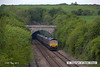 130517-006     GBRf class 66/7 no. 66706 Nene Valley emerges from Whitwell tunnel, powering train 6B59, 1200 Thoresby Colliery to West Burton Power Station, loaded coal hoppers.