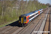 130502-007     East Midlands Trains class 158's no's 158852 & 158813 form 1L05, the 0647 Liverpool Lime Street to Norwich & are captured arriving at Langley Mill.