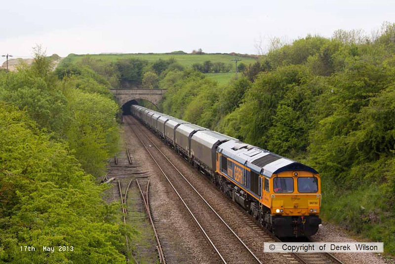 130517-017     GBRf class 66/7 no. 66732 is captured emerging from Whitwell tunnel, powering train 4Z20, 1330 Shirebrook Davis & Son to Doncaster Down Decoy, hauling a rake of twenty one new biomass hoppers, wagon type IIA.