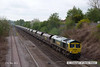 130511-011     Freightliner class 66/5 no. 66595 passes Langley Mill, powering train 4E15, 0824 Ratcliffe Power Station to Doncaster Down Decoy, hauling a rake of empty coal hoppers.