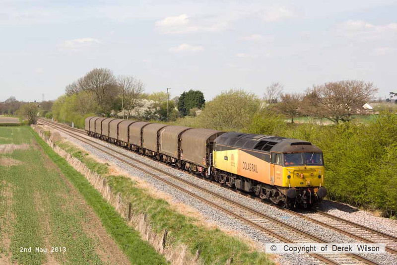 130502-040     On Thursday 2nd May the 'Boston steel' ran to the earlier path, leaving Washwood Heath at 11.31. as 6Z07 to Boston docks. Entrusted to class 47 no. 47749 Demelza, it is captured in the sun, passing Barrow upon Trent.