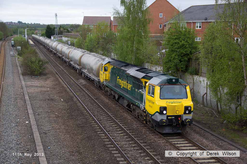 130511-018     Freightliner class 70 no. 70010, captured passing Langley Mill, powering train 6M90, 0445 West Thurrock Sidings to Tunstead Sidings, hauling a rake of empty Lafarge cement tanks.