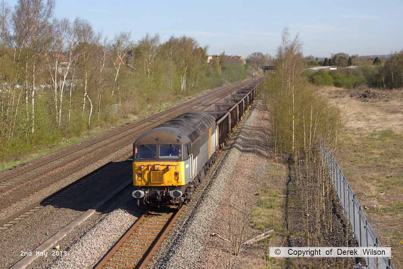 130502-006     The Class 56 Groups 56301 is captured passing Langley Mill, powering 6Z56, 0728 York Holgate Sidings to Chaddesden Sidings hauling the rake of JRA's that are being used for the Kellingley - Thoresby diagram.