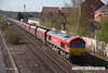 130502-010     DB Schenker red class 66/0 no. 66152 passes through Langley Mill, powering a 0900 Toton North Yard to Immingham Sorting Sidings, hauling a rake of empty coal hoppers.