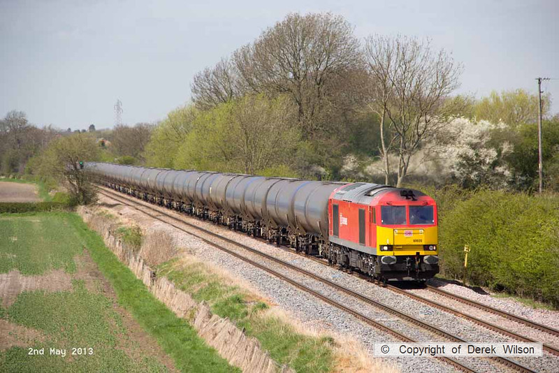 130502-027     DB Schenker 'super tug', class 60 no. 60020 passing Barrow upon Trent, powering train 6E54, 1040 Kingsbury Oil Sidings to Humber Oil Refinery, empty bogie tanks.