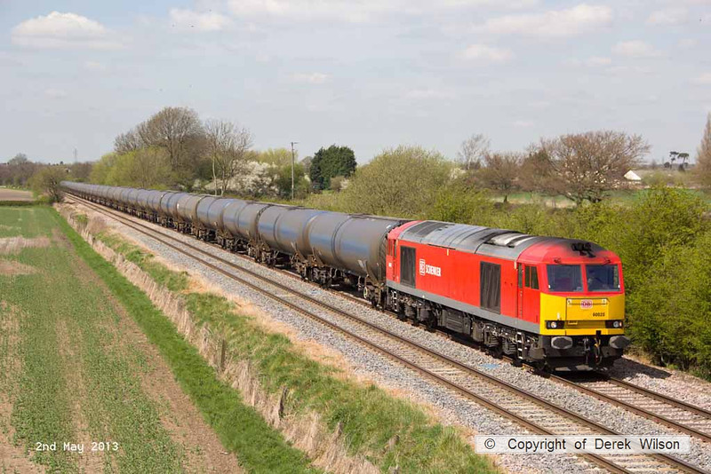 130502-031     DB Schenker 'super tug', class 60 no. 60020 passing Barrow upon Trent, powering train 6E54, 1040 Kingsbury Oil Sidings to Humber Oil Refinery, empty bogie tanks.