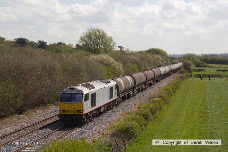 130502-022     DB Schenker class 60 no. 60099 is captured passing Barrow upon Trent, powering 6M57, 0752 Lindsey Oil Refinery to Kingsbury Oil Sidings, loaded bogie tanks, fuel-oil.