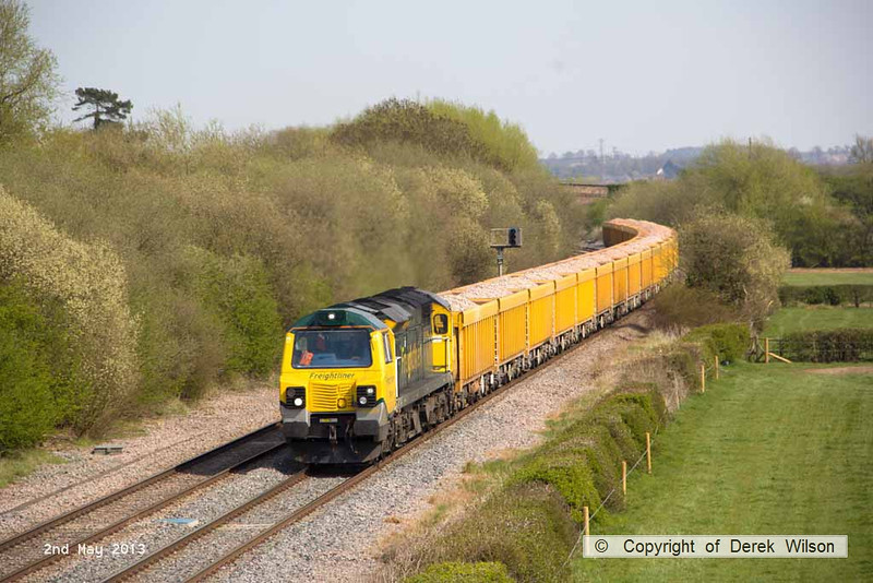 130502-053     Freightliner class 70 no. 70015, captured passing Barrow upon Trent powering train 6U77, 1344 Mountsorrel to Crewe Basford Hall, loaded (ballast) bogie boxes.