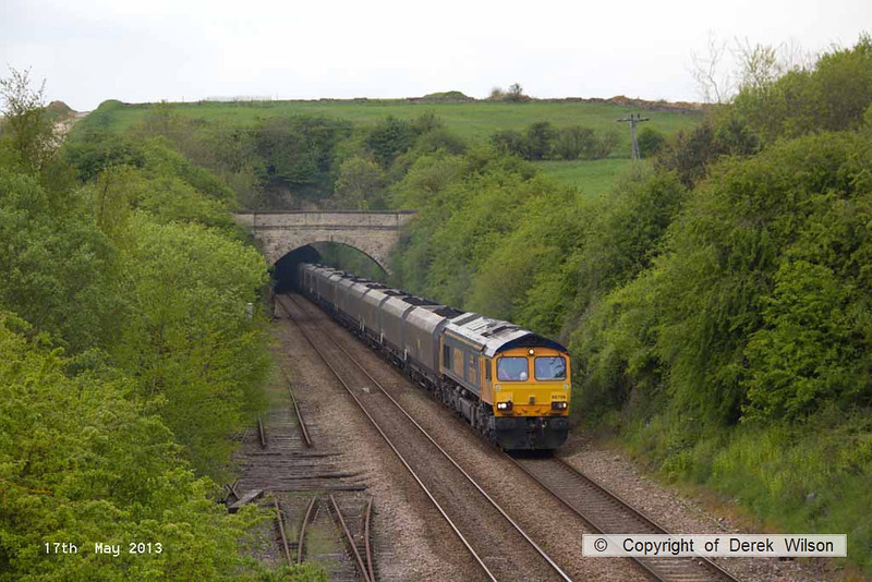 130517-008     GBRf class 66/7 no. 66706 Nene Valley emerges from Whitwell tunnel, powering train 6B59, 1200 Thoresby Colliery to West Burton Power Station, loaded coal hoppers.