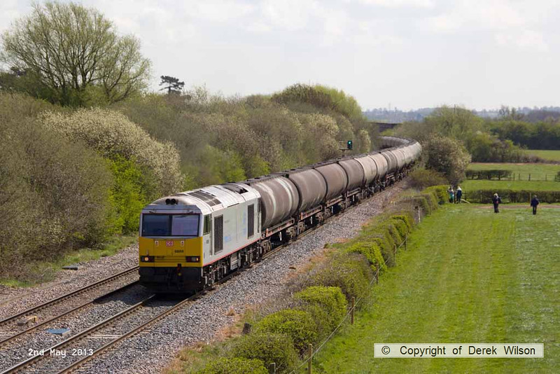 130502-019     DB Schenker class 60 no. 60099 is captured passing Barrow upon Trent, powering 6M57, 0752 Lindsey Oil Refinery to Kingsbury Oil Sidings, loaded bogie tanks, fuel-oil.