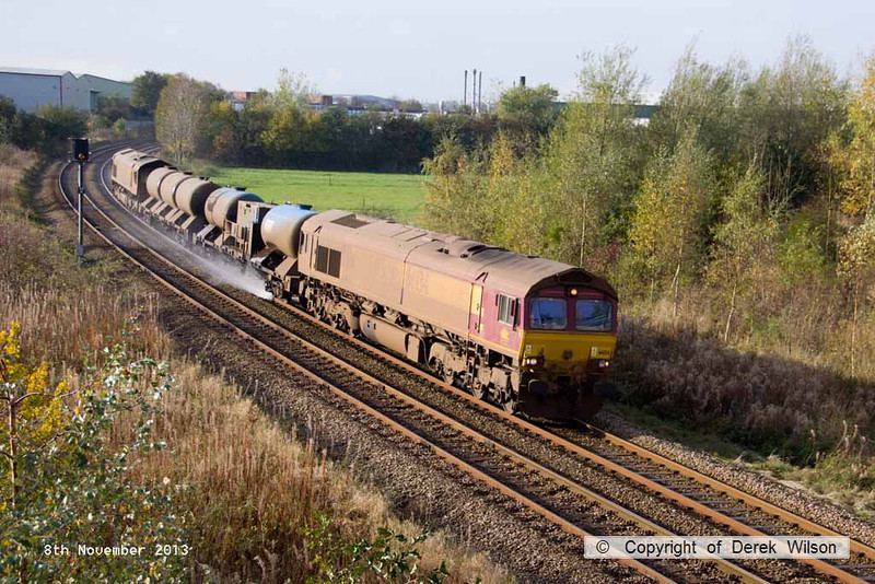 131108-002      DB Schenker class 66/0's no's 66134 (leading) & 66140, captured passing Sutton in Ashfield, with Rail Head Treatment Train 3J88, the 20.57 Toton TMD to Toton TMD. Seen heading to Shirebrook, where the train reverses & heads to Nottingham, then in to Lincolnshire, via Newark.