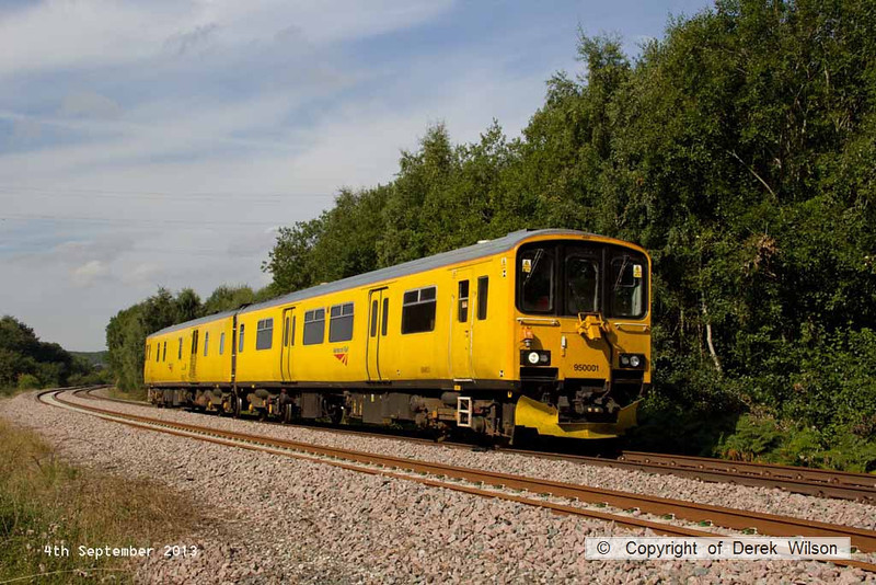 130904-003     Network Rail's class 950 track recording unit no 950001 is captured passing Ollerton pit tip wood, on the High Marnham Test Track. It is seen heading towards Marnham, running as 2Q08, the 08.35 Derby R.T.C. to Derby R.T.C.