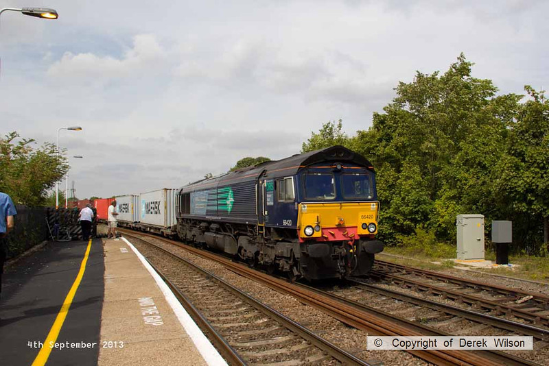 130904-005     Freightliner class 66/4 no 66420 which is, surprisingly, still in full DRS livery, is seen passing through Gainsborough Lea Road powering Intermodal service 4L85, the 11.49 Doncaster Europort to Felixtowe North.