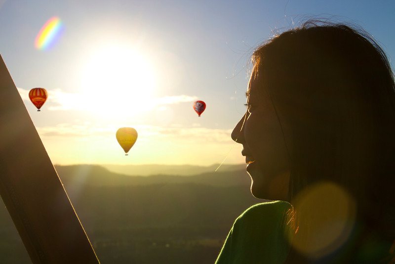 Hot Air Balloon Gold Coast Brisbane Asian lady turning to balloons smiling_lge
