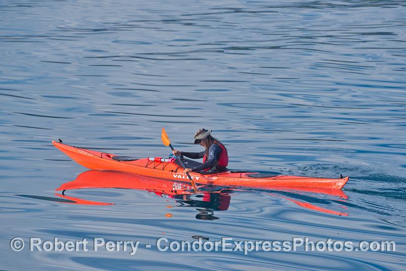 Kayak on glassy sea.