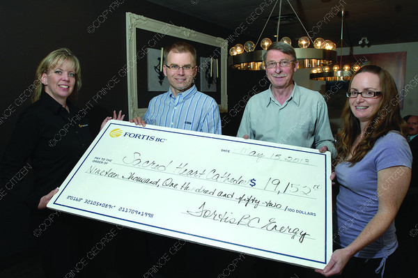 FortisBC gives a rebate cheque to Sacred Heart Cathedral left to right Shelley Thomson with Fortis BC, Ferenc Pataki with FortisBC, Ron Walsh and Jennifer Foster with Sacred Heart Cathedral. Citizen photo by Brent Braaten    May 15 2013