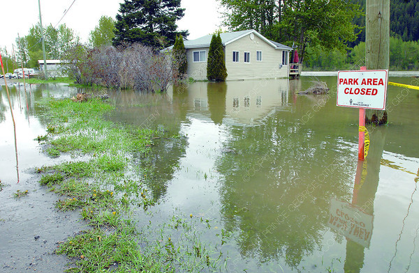 Water is up to some of the houses on Ferrell Street Wednesday morning. Citizen photo by Brent Braaten    May 15 2013
