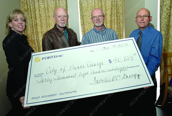 FortisBC gives a rebate cheque to City of Prince George  left to right Shelley Thomson with Fortis BC, Pat Flack  with FortisBC, Rod Croome and Greg Anderson with City of Prince George . Citizen photo by Brent Braaten    May 15 2013