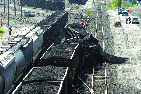 Three derailed coal cars in the CN Rail Yard near the Cameron Street overpass Thursday morning. Citizen photo by Brent Braaten  May 16 2013