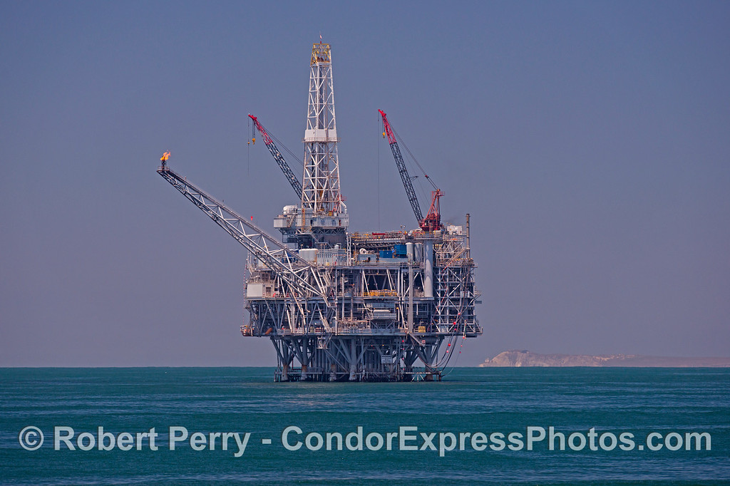 Oil platform Heritage is seen with Point Conception in the background, up in the far west Santa Barbara Channel.