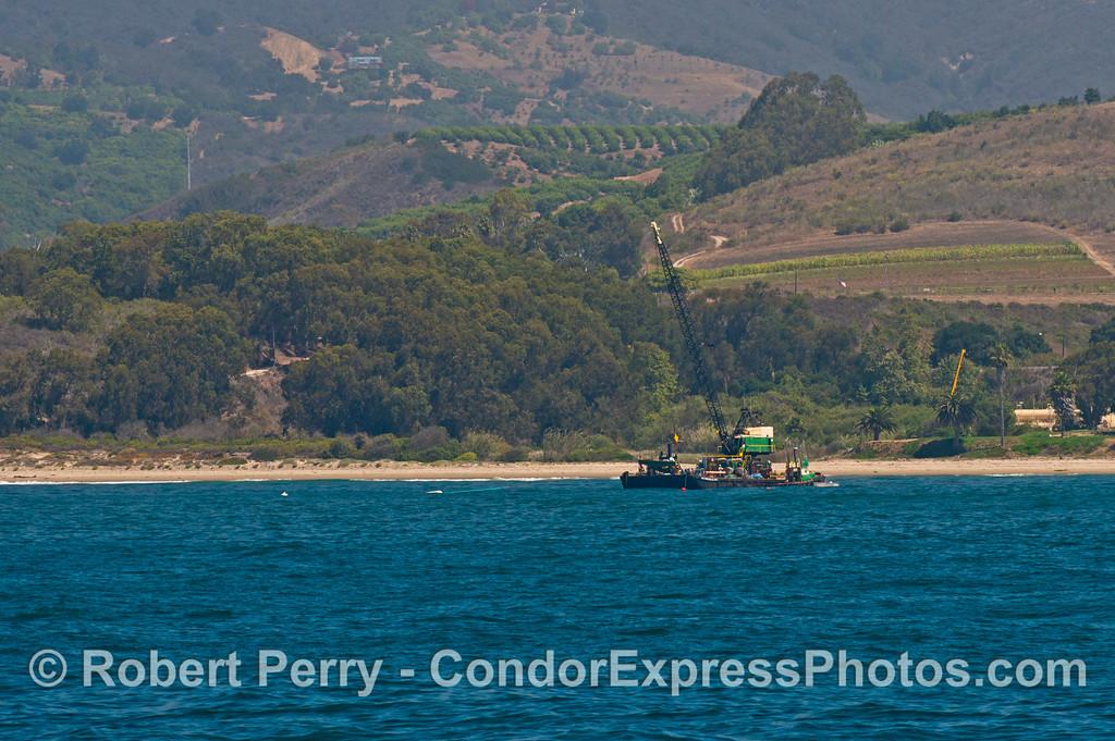 A crane barge near the beach - western Santa Barbara coast.