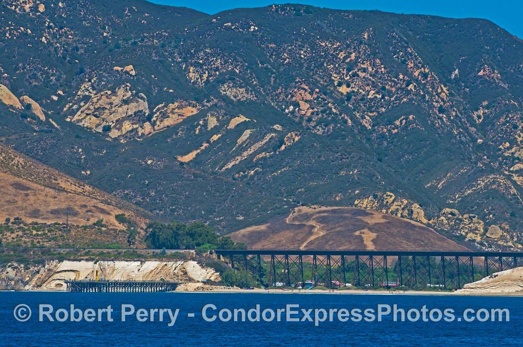 Coastal scenery - far west Santa Barbara coast - Gaviota pier and railroad overpass.