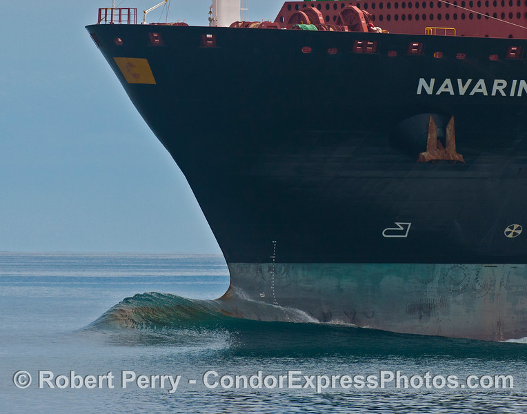 "Navarino is a 1,099 foot long, 91,354 gross ton container carrying vessel.  The water flowing over the ships bulbous bow creates an interesting wave pattern.  You can track this ship (as of July 23, 2013) at:<br /> <a href=""http://www.marinetraffic.com/ais/default.aspx?mmsi=241015000&centerx=-122.3389&centery=37.80798&zoom=10&type_color=7"">http://www.marinetraffic.com/ais/default.aspx?mmsi=241015000&centerx=-122.3389&centery=37.80798&zoom=10&type_color=7</a>"