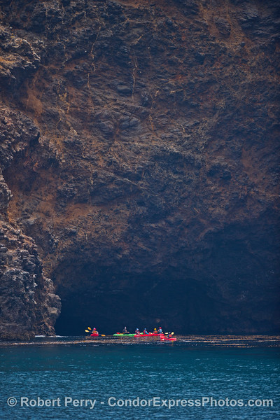 A group of kayakers enjoy one of over 100 sea caves on Santa Cruz Island.