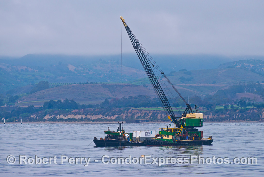 A crane barge helps lay down a new electricity supply cable to Platform Holly.