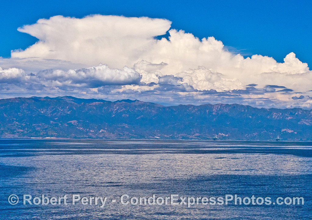 Storm clouds blossom over the Santa Ynez Mountains from the subtropical moisture.