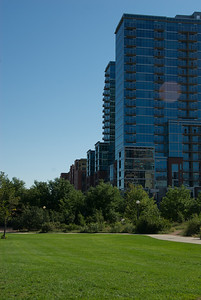 Denver blue apartments on a bright green morning.
