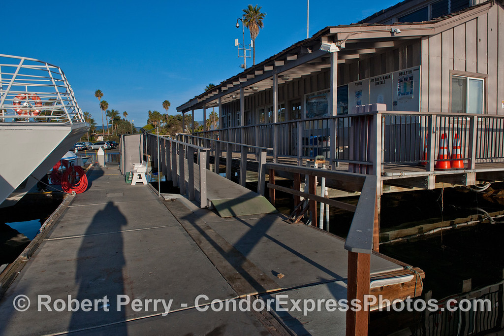 King Tides:  high tide - bow of Condor Express, walk ramp and the Sea Landing, Santa Barbara Harbor.