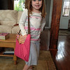 Anna in her outfit and purse from Doug & Kati