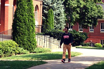 A Gardner-Webb University student walking to class.