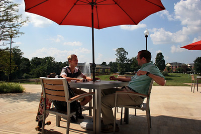 Two students talk on the patio of the Tucker Student Center on a beautiful fall day at Gardner-Webb University.