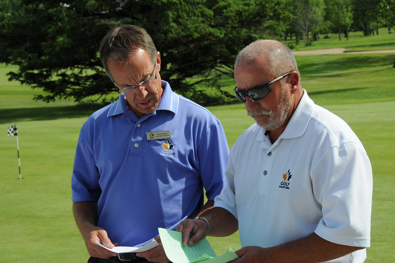 Gord Hudson, Tournament Administrator and Kevin O'Donovan, Breezy Bend member and President Elect of Golf Manitoba